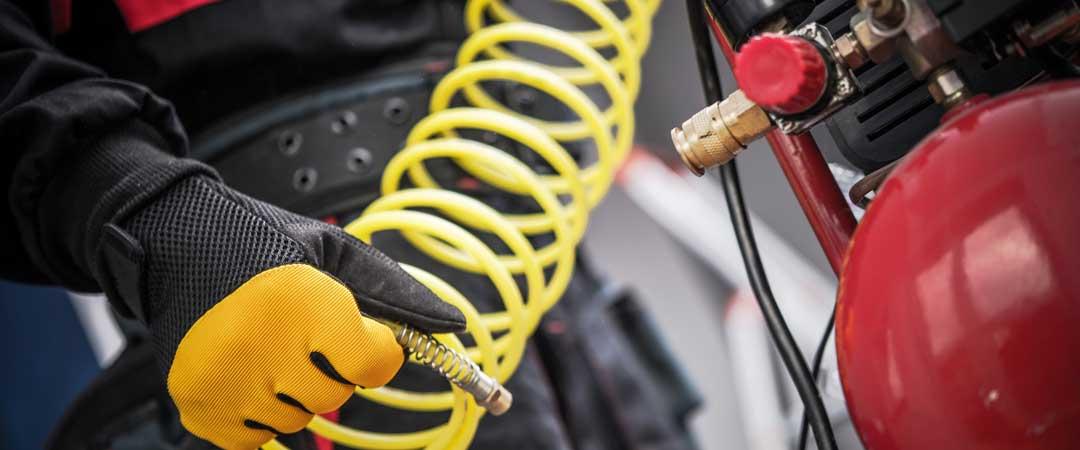 Man holding an air compressor hose
