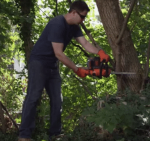 Black & Decker LCS1240 battery powered chainsaw in action