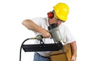 Carpenter using a nailer
