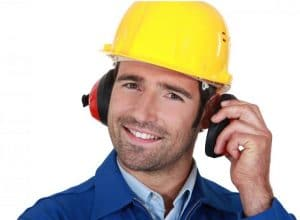 Contractor wearing safety gear- helmet and ear protection against noise
