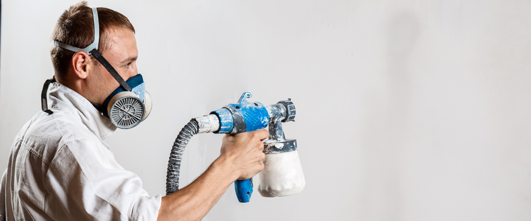 Man spraying texture onto a wall