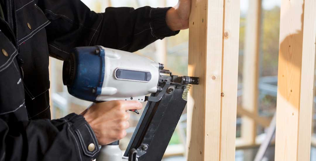 Worker with an air nailer