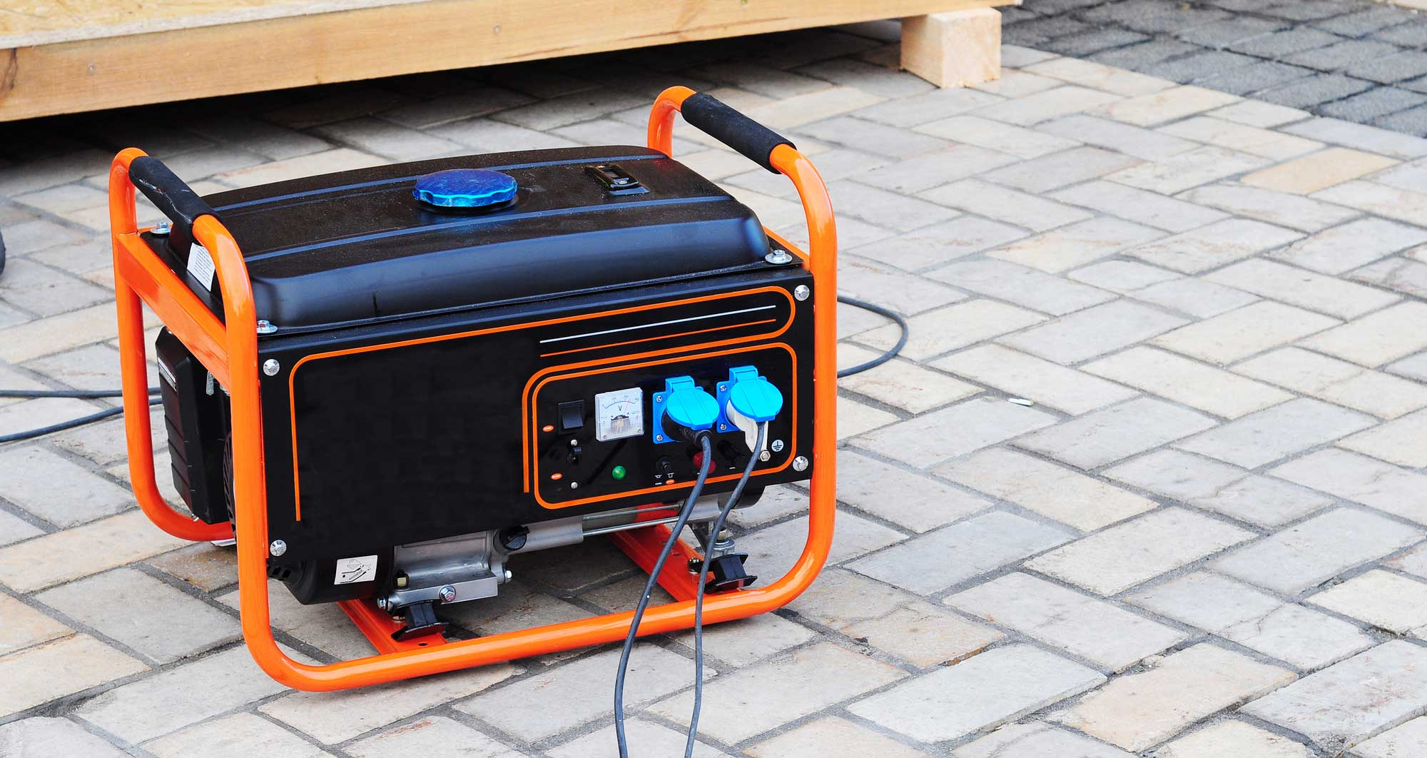 Portable generator on a brick patio