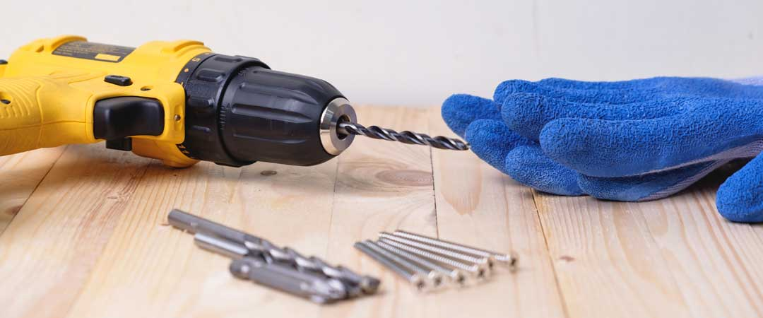 Drill and bits with blue gloves