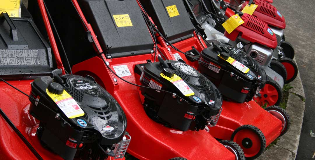 Red Gas and battery powered mowers on display
